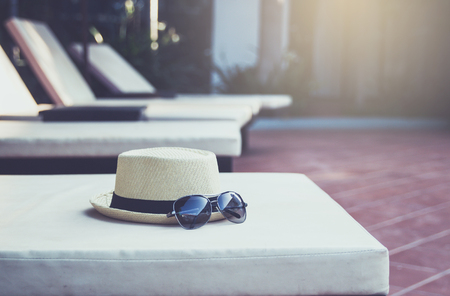 Hat and sunglasses at the pool,Summer holiday concept.