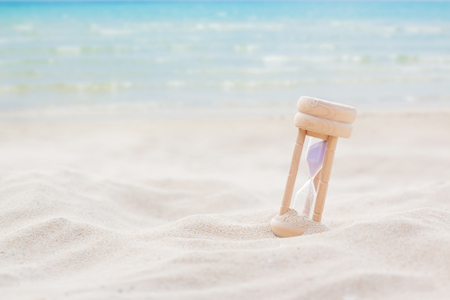 Time concept with hourglass on sand beach and copy space. Imagens - 84801952