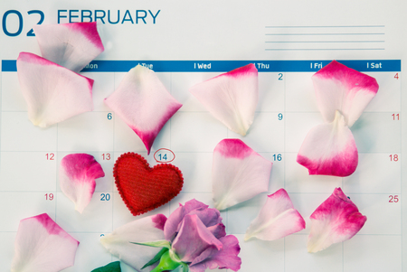 Valentines Day with hearts and rose on calender.