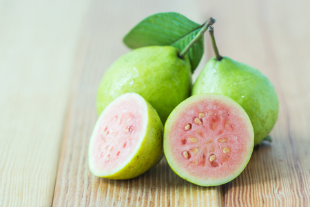 Fresh guava fruit on wooden table. Stock Photo