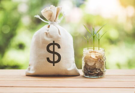 Money saving and money bag with coin in glass. Stock Photo