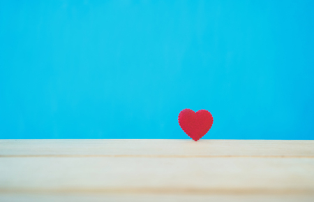 Red heart on wooden for valentine day love concept,Minimal creative style.