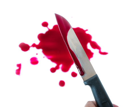 A knife smeared with blood in hand on white background with clipping path. Фото со стока