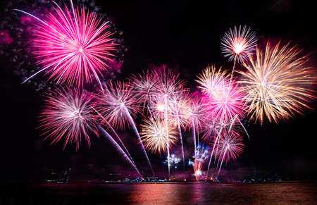 colorful fireworks on the black sky background over the sea. Imagens