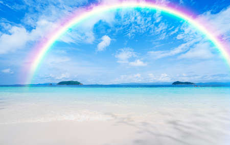 Colorful rainbow in blue sky over the sea.