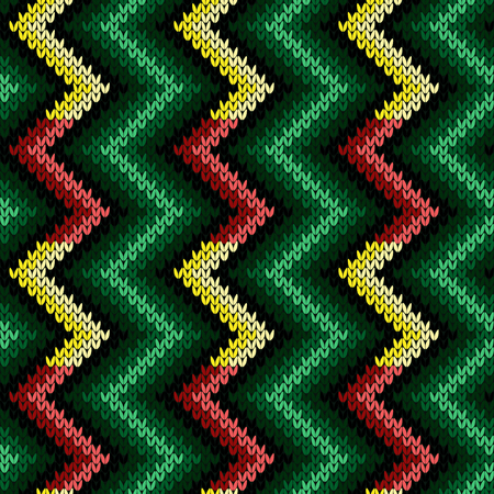 Knitted seamless decorative pattern with zigzag lines in green, red and yellow hues on the dark background, vector as a fabric texture