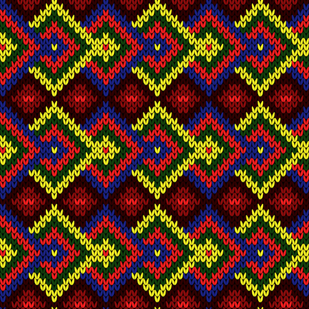 Contrast colorful knitted seamless pattern in red, blue, yellow and green colors, vector pattern as a fabric texture