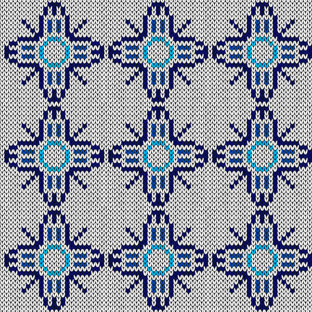 Seamless knitted ornate vector pattern in blue and white colors as a fabric texture