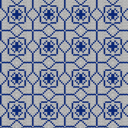 Geometrical ornate seamless knitted vector pattern as a fabric texture in blue and white hues
