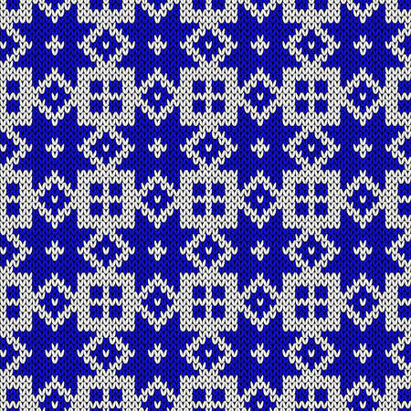 Ornamental knitting seamless vector pattern in blue and white colors with snowflakes as a fabric texture