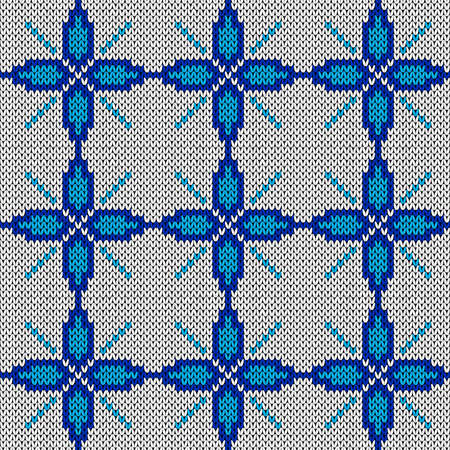 Ornate knitting seamless vector pattern in blue and white hues as a fabric texture