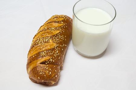 Healty breakfast, roll with sesamo and glass of fresh milk. Backery, bread, breakfast.