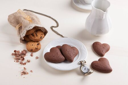 Heart shaped biscuits of chocolate with rustic cookies  photo