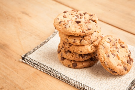 Chocolate rustic biscuits, wooden background  photo