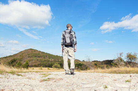 Young man walking in nature Imagens