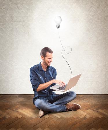 Young man holding a laptop, concept idea