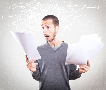 Young man stressed holding papers