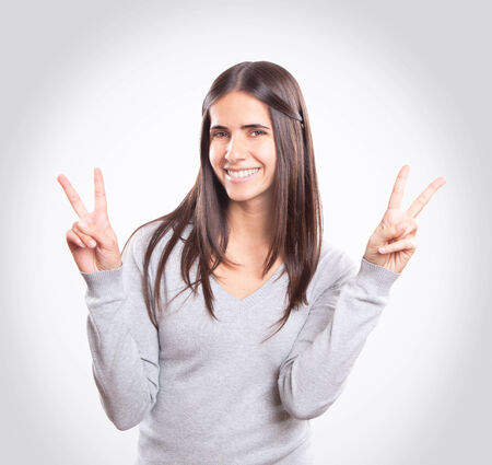 Young happy brunette, victory sign