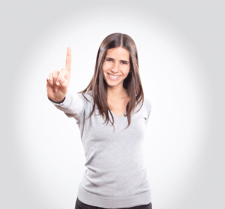 Young woman showing one finger Imagens