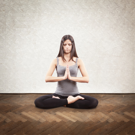 Young brunette doing yoga