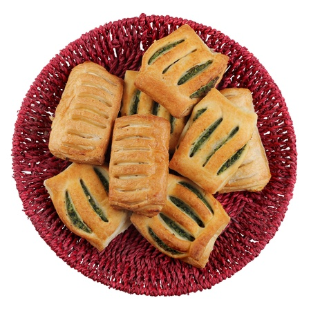 Strudel with spinach and cottage cheese on the roun rad plate Stock Photo