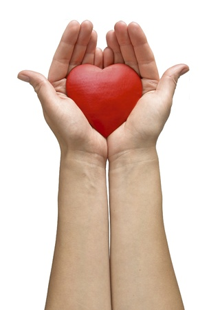 hands holding heart: Woman hands holding heart isolated on white background Stock Photo