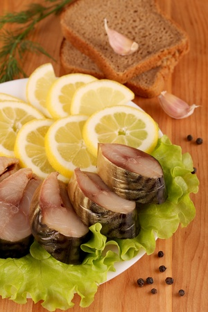 Composition with Smocked Mackerel Fish, Lemon and Salad Leaves on Wooden Table.  Stock Photo