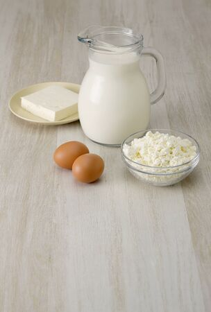 Dairy Products Cheese Eggs Milk Curd on White Wooden Table Stock Photo