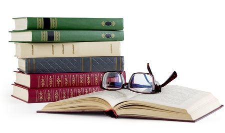 Old books and glasses on the white background