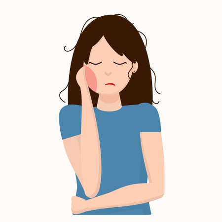 young woman holding her cheek because of toothache (bad tooth), dental care and dentistry concept