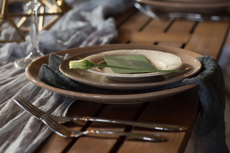 The decor of the festive table. Dishes. Close-up.