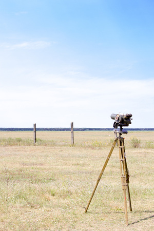 Geodetic device at the airport. Surveying instruments. Geodetic instruments on the airfield.