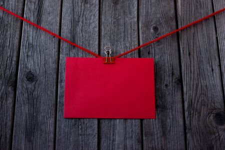 Happy Valentine's Day. 14 February! Red envelope, ribbon. Postcard, booklet. Discounts, sale. Black Friday! Design for background, space for copying.