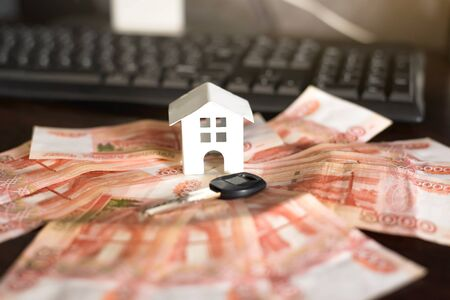 House, house, real estate, real estate lease lease agreement money keys, expenses, purchase, investment, Finance, savings, concept close -up selective focus. Фото со стока