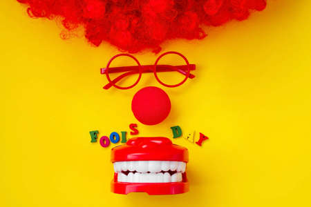 April fool's day, calendar date is April 1. Clown nose, glasses, jaw, wooden letters. It's funny.
