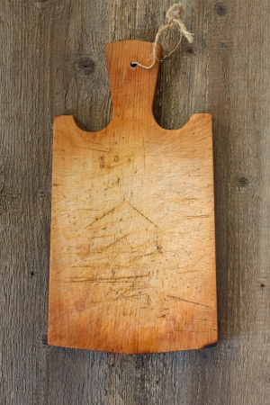 old cutting board on a wooden background