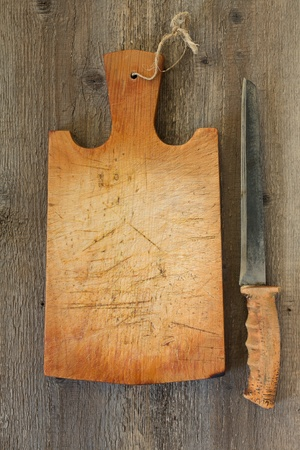 old cutting board on a wooden background photo