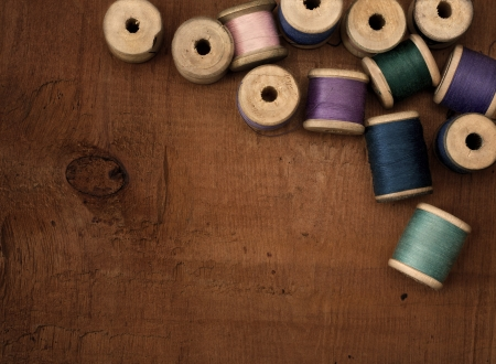 Old spools of thread on a wooden