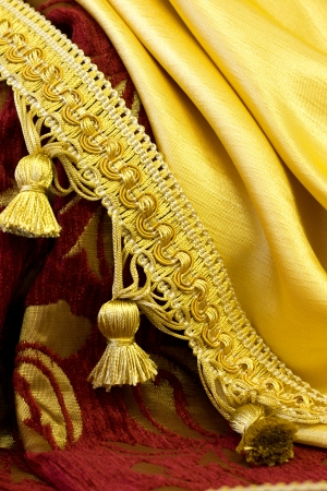 golden fringe on the background of curtain fabrics photo
