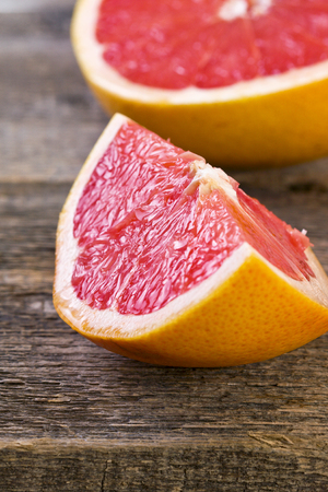 slice of grapefruit  on a wooden background photo