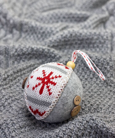 Christmas ball on the background of knit
