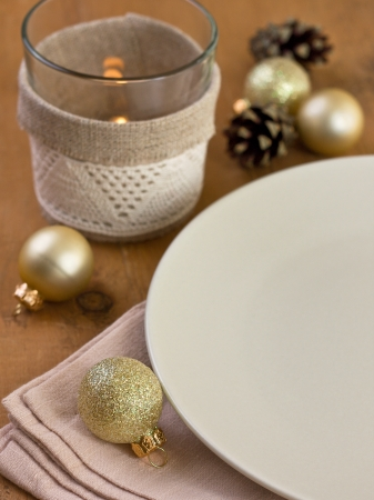 Christmas table setting with  pine cones and Christmas balls with empty space photo