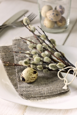 Easter table setting  with quail eggs, willow branches 스톡 콘텐츠