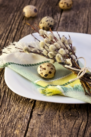 Easter table setting  with quail eggs, willow branches photo