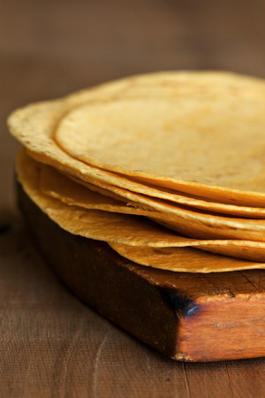 tortillas: Stack of  Flour Tortillas on a wooden