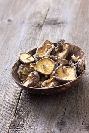 dried shiitake in a bowl on a wooden