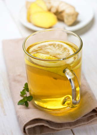 tea with ginger and lemon in a glass mug photo