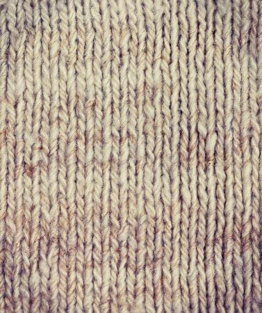 ウール糸 (ビンテージ スタイル) の編み物のファブリックの背景 写真素材