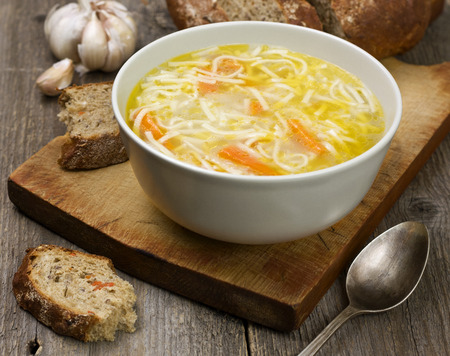 noodle soup in a bowl on a wooden background 스톡 콘텐츠