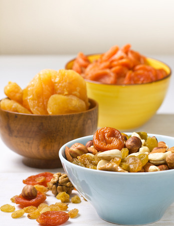 nuts and dried fruits on wooden background 스톡 콘텐츠